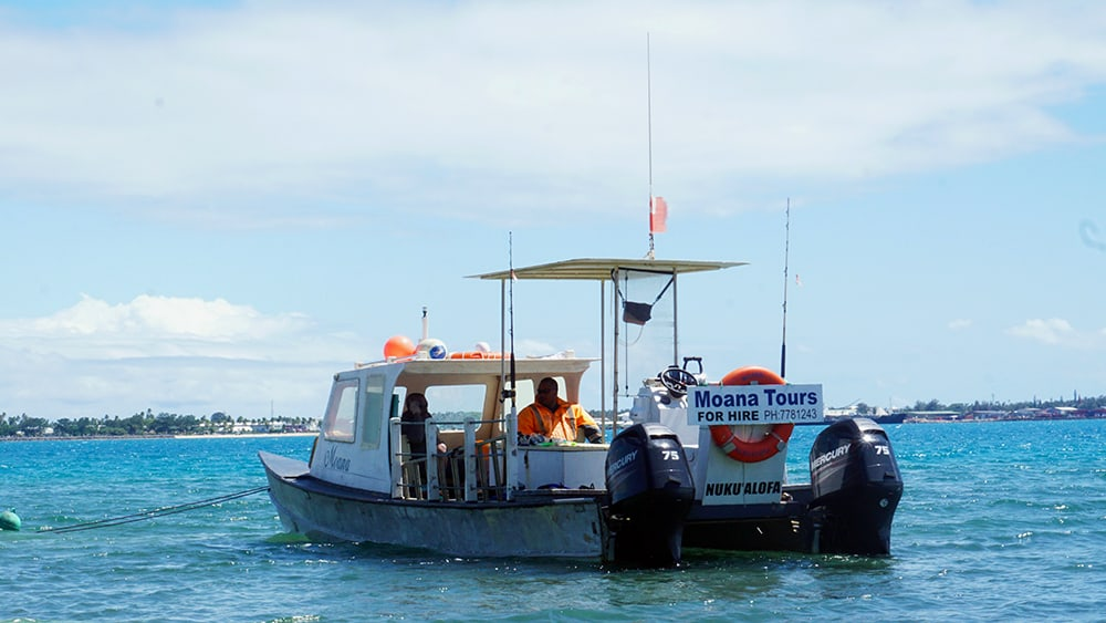 Moana Tours' small boat at the Tongatapu jetty preparing to take us whale swimming